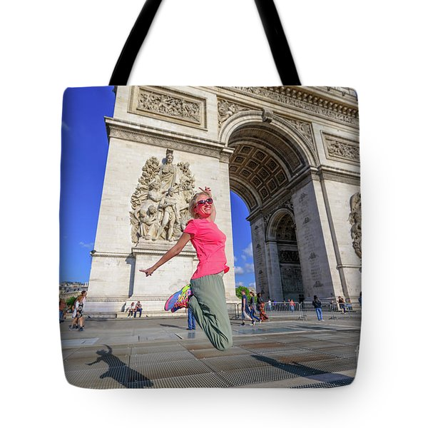 Tote Bag featuring the photograph Jumping At Arc De Triomphe by Benny Marty