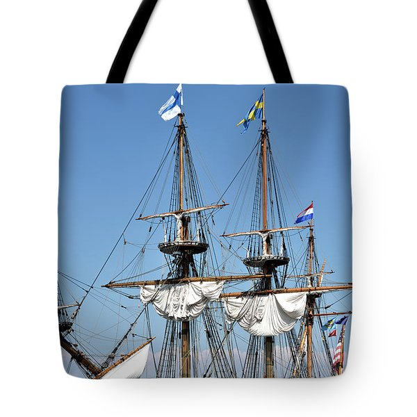 Tote Bag featuring the photograph Kalmar Nyckel - Docked In Lewes Delaware by Brendan Reals