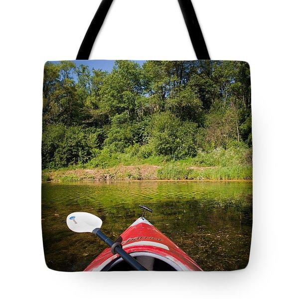 Kayak On A Forested Lake Tote Bag