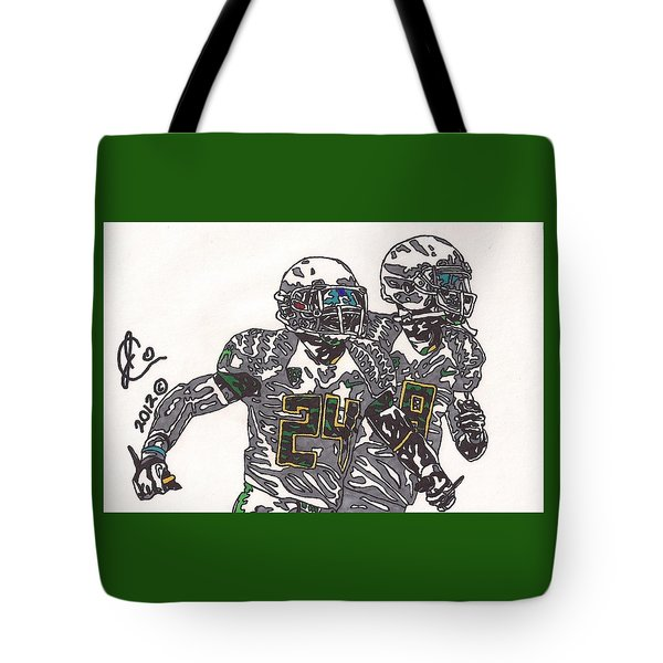 Kenjon Barner And Marcus Mariota Tote Bag by Jeremiah Colley