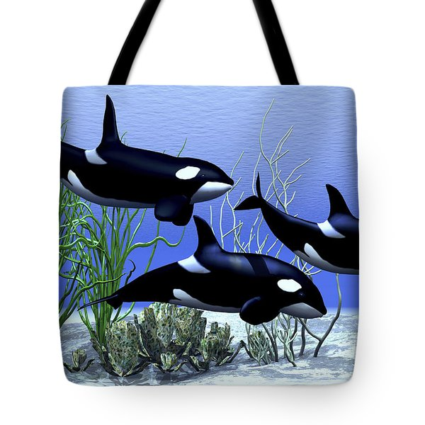 Killer Whales Hunt Together Tote Bag by Corey Ford
