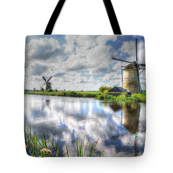 Tote Bag featuring the photograph Kinderdijk by Uri Baruch