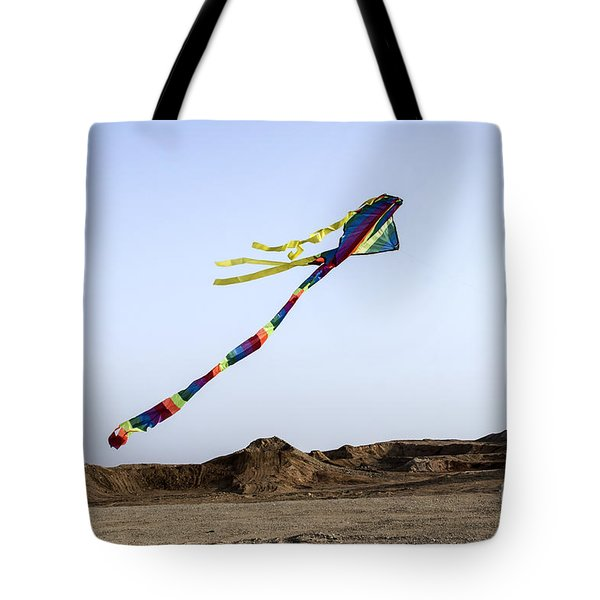 Tote Bag featuring the photograph Kite Dancing In Desert 04 by Arik Baltinester