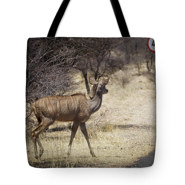 Tote Bag featuring the photograph Kudu Crossing by Ernie Echols