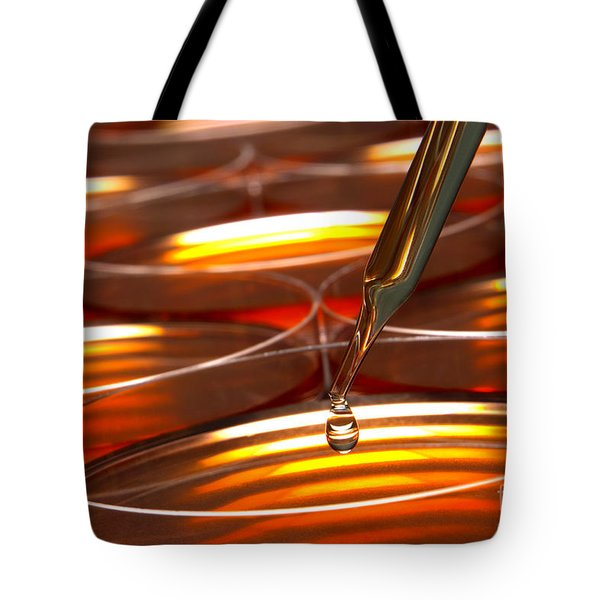 Tote Bag featuring the photograph Laboratory Petri Dishes In Science Research Lab by Olivier Le Queinec