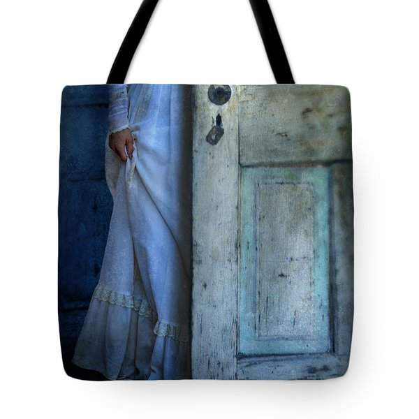 Lady In Vintage Clothing Hiding Behind Old Door Tote Bag by Jill Battaglia