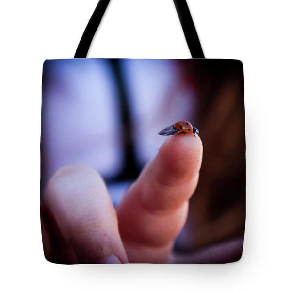 Tote Bag featuring the photograph Ladybug On  Finger  by Bruno Spagnolo