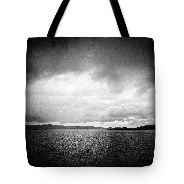 Lake And Dramatic Sky Black And White Tote Bag by Matthias Hauser