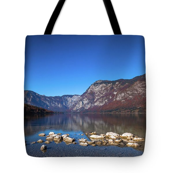 Tote Bag featuring the photograph Lake Bohinj by Davor Zerjav