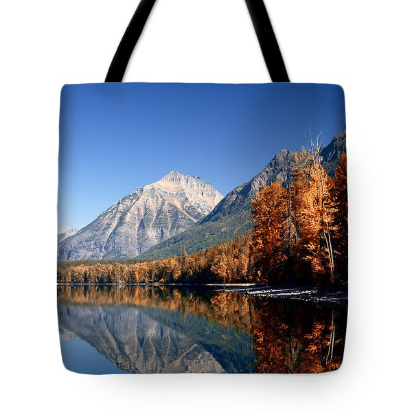 Lake Mcdonald Autumn Tote Bag by Lawrence Boothby