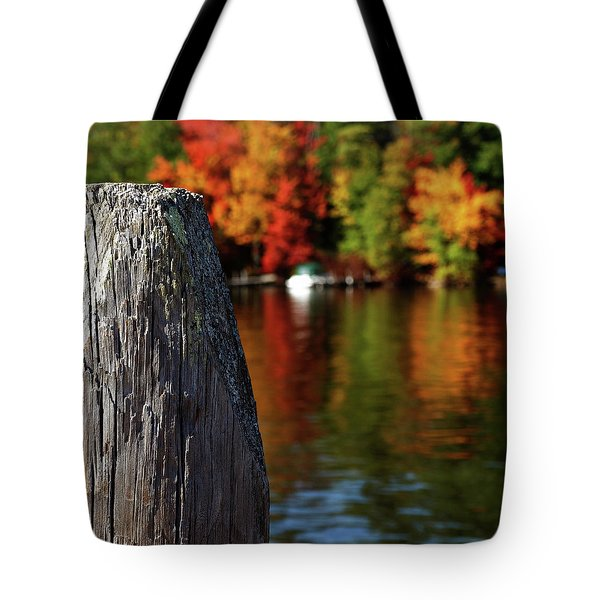 Lake Winnepesaukee Dock With Foliage In The Distance Tote Bag