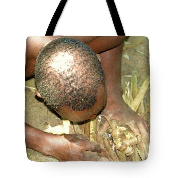 Lamu Island - Man Breathe Life Into A Fire 1 Tote Bag