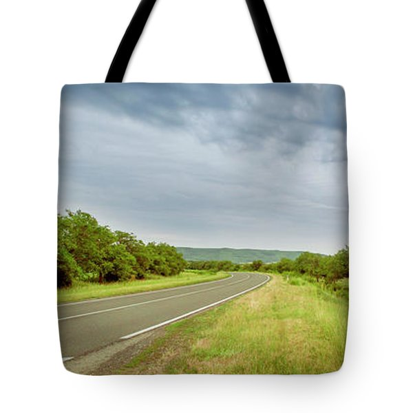 Landscape With Highway And Cloudy Sky Tote Bag