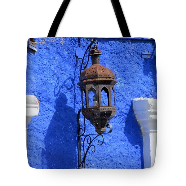 Lantern On Blue Wall Tote Bag by Randall Weidner