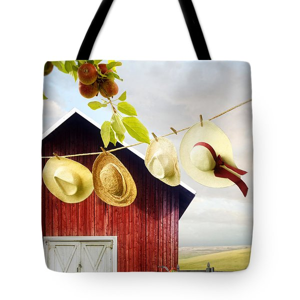 Large Red Barn With Hats On Clothesline In Field Of Wheat Tote Bag by Sandra Cunningham
