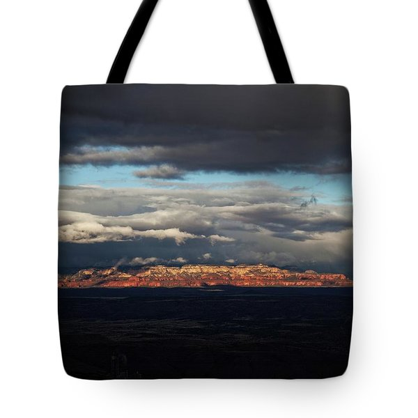 Tote Bag featuring the photograph Late Light On Red Rocks With Storm Clouds by Ron Chilston