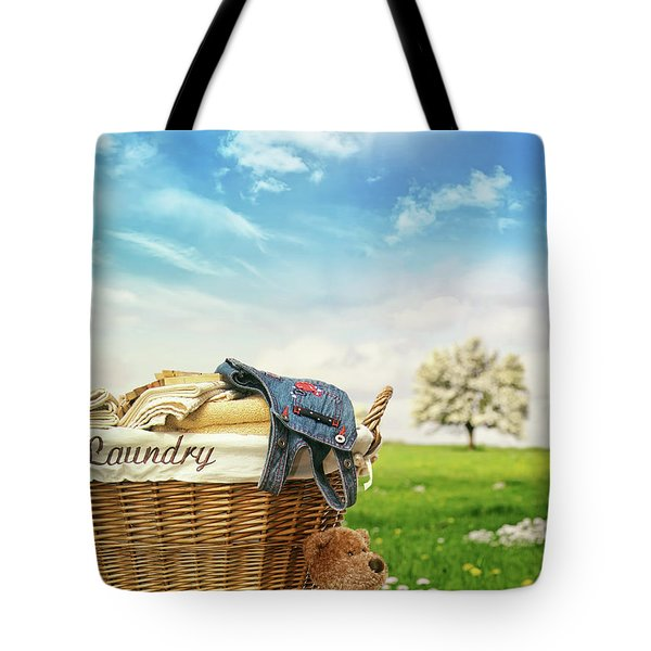 Laundry Basket With Clothes Against A Blue Sky Tote Bag