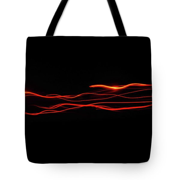 Tote Bag featuring the photograph Lazer by Scott Cordell
