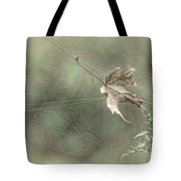 Leaf In Spiderweb Tote Bag