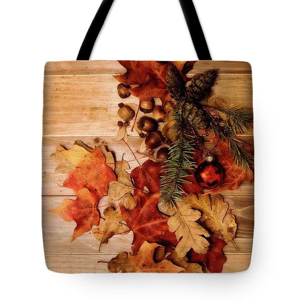 Tote Bag featuring the photograph Leaves And Nuts And Red Ornament by Rebecca Cozart