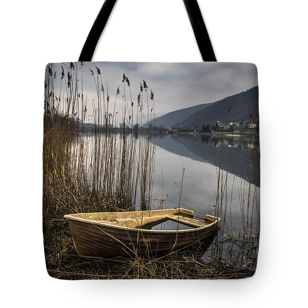 Tote Bag featuring the photograph Left Alone by Yuri Santin
