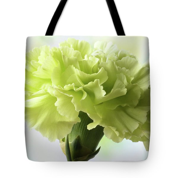 Tote Bag featuring the photograph Lemon Carnation by Terence Davis