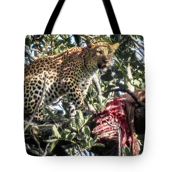 Tote Bag featuring the photograph Leopard Eating Impala In A Tree by Gregory Daley  PPSA