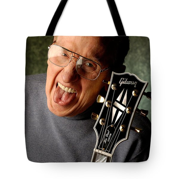 Les Paul With Tongue Out By Gene Martin Tote Bag