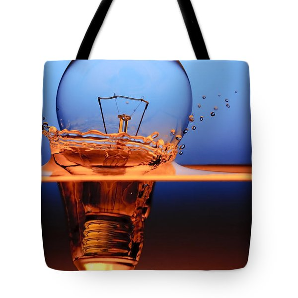 Tote Bag featuring the photograph Light Bulb And Splash Water by Setsiri Silapasuwanchai