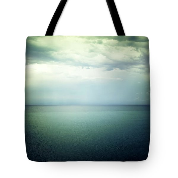 Light In The Sky Above The Dark Gloomy Sea Tote Bag by GoodMood Art