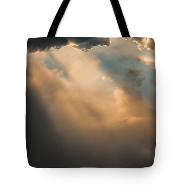 Light Punches Through Darkness Tote Bag
