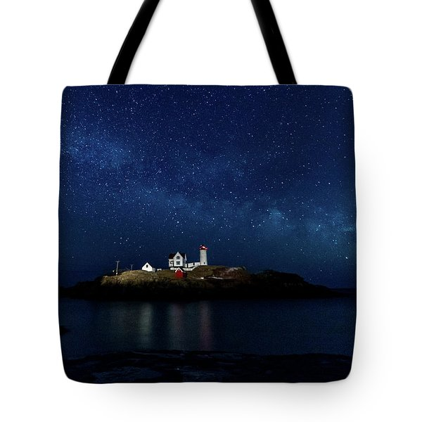 Tote Bag featuring the photograph Light Up Nubble Lighthouse by Darryl Hendricks