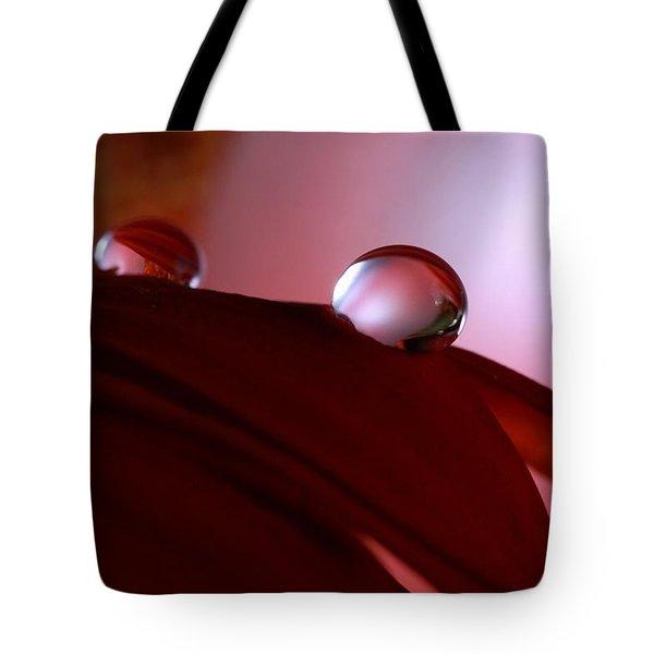 Light Water Drop On Dark Petals Tote Bag
