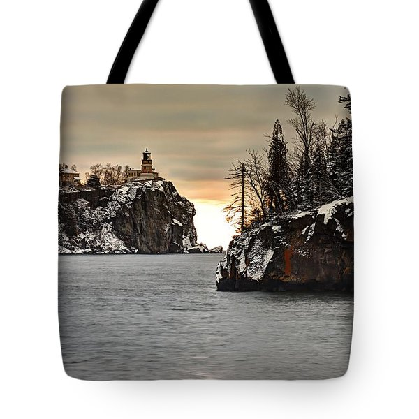 Lighthouse And Island At Dawn Tote Bag by Larry Ricker