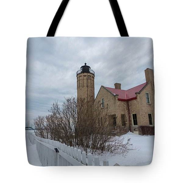 Tote Bag featuring the photograph Lighthouse And Mackinac Bridge Winter by John McGraw