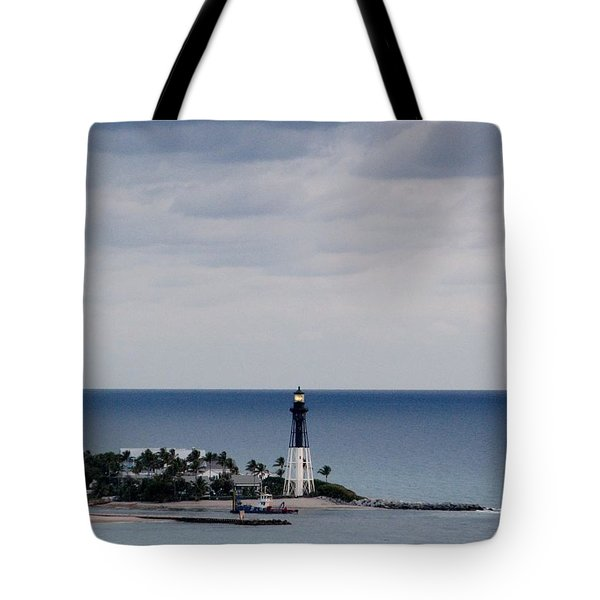 Lighthouse And Rain Clouds Tote Bag