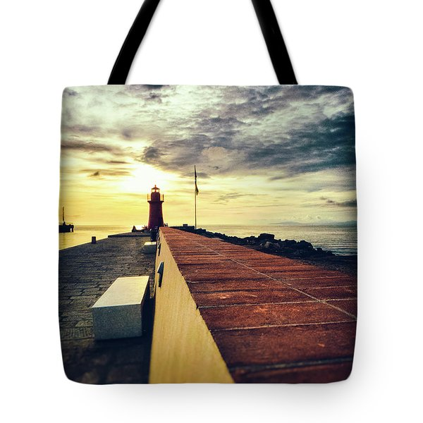 Tote Bag featuring the photograph Lighthouse At Sunset by Silvia Ganora