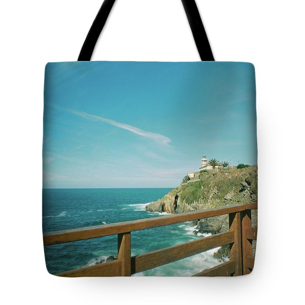 Lighthouse Over The Ocean Tote Bag