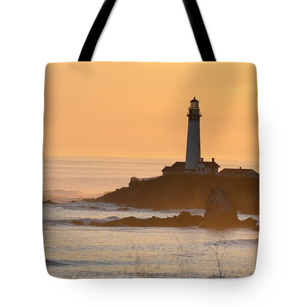 Tote Bag featuring the photograph Lighthouse Sunset by Alex King