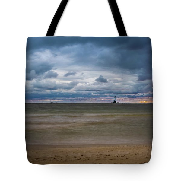 Tote Bag featuring the photograph Lighthouse Under Brewing Clouds by Lester Plank