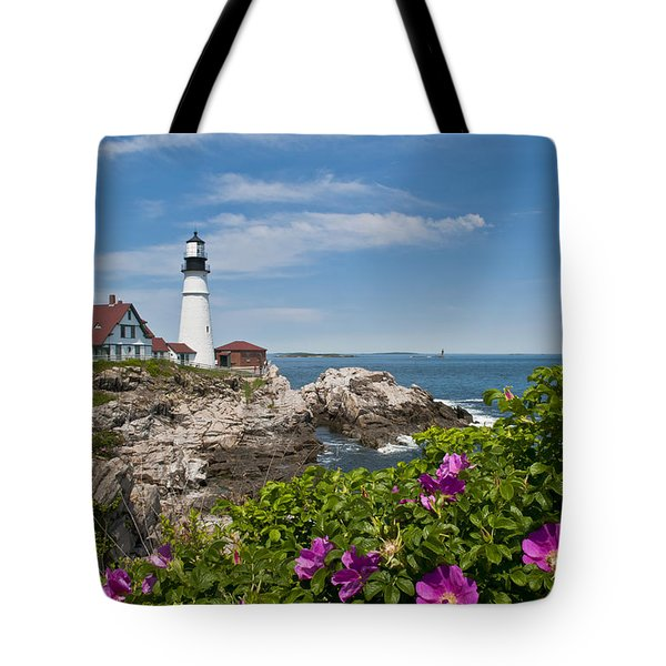 Lighthouse With Rocks On Shore Tote Bag by Bill Bachmann and Photo Researchers