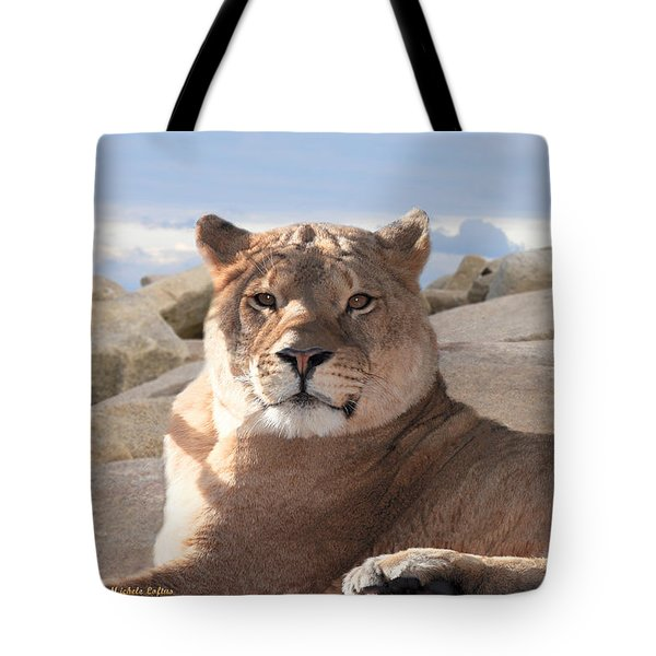 Tote Bag featuring the photograph Lion by Michele A Loftus