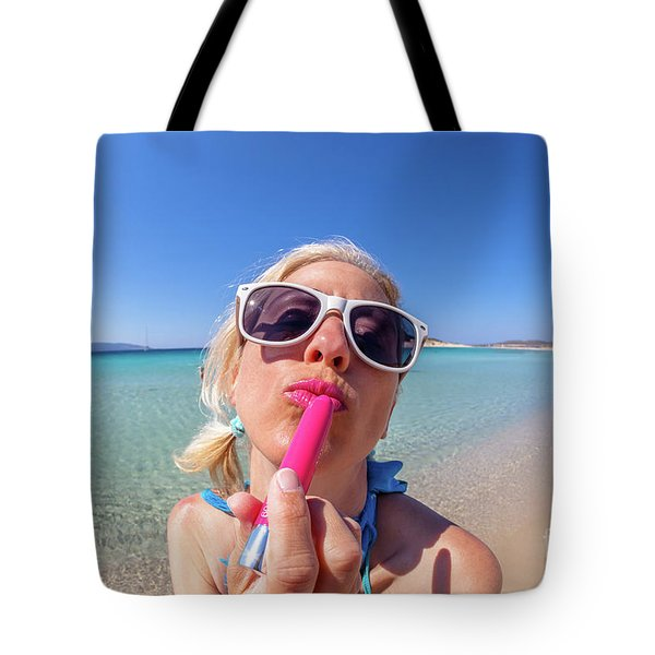 Tote Bag featuring the photograph Lipstick Applying by Benny Marty