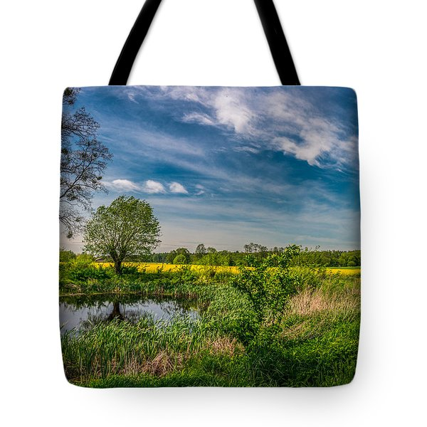 Tote Bag featuring the photograph Little Pond Near A Rapeseed Field by Dmytro Korol