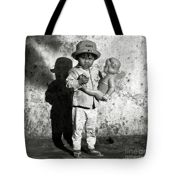 Tote Bag featuring the photograph Little Vietnamese Girl Playing With Her Doll by Silva Wischeropp