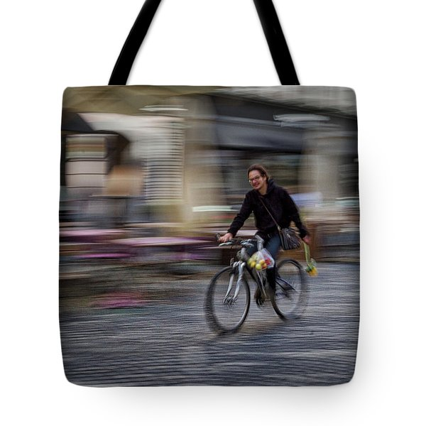 Tote Bag featuring the photograph Ljubljana Bicycle Rider - Slovenia by Stuart Litoff