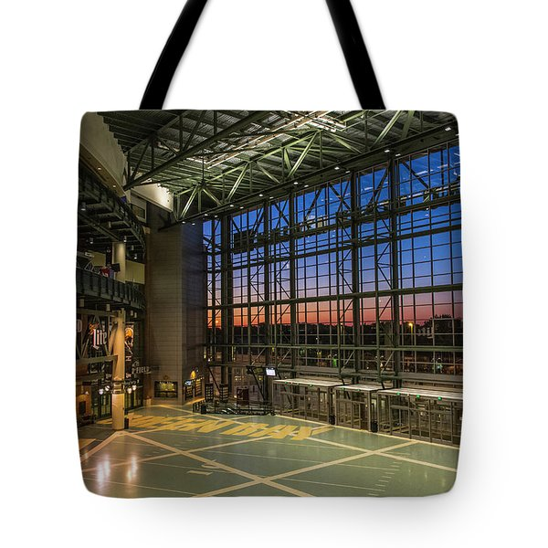 Tote Bag featuring the photograph Lambeau Field Atrium Sunset by Joel Witmeyer