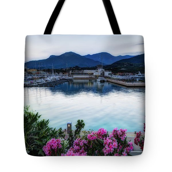 Tote Bag featuring the photograph Loano Sunset Over Sea And Mountains With Flowers by Enrico Pelos