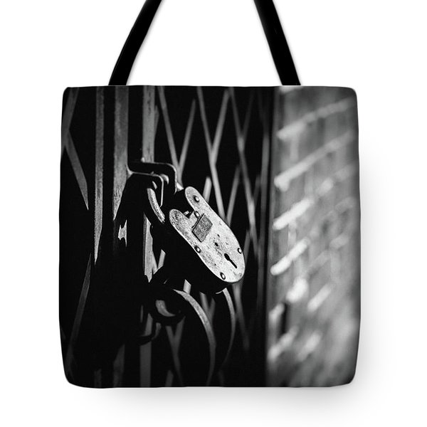 Tote Bag featuring the photograph Locked Away by Doug Camara