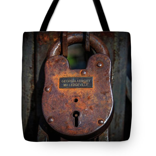 Tote Bag featuring the photograph Locked Up Tight by Doug Camara